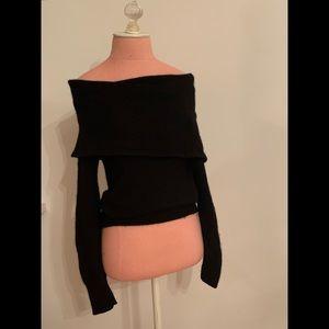 Black sweater off the shoulder